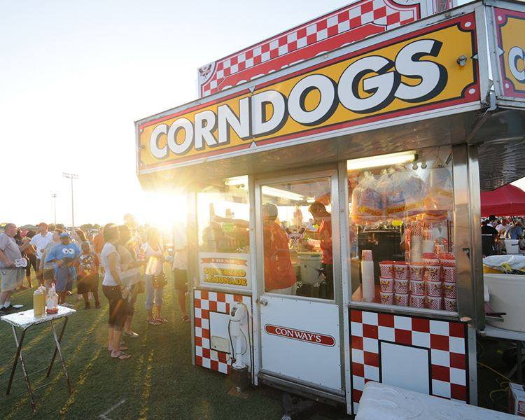 a corn dog food truck selling to people