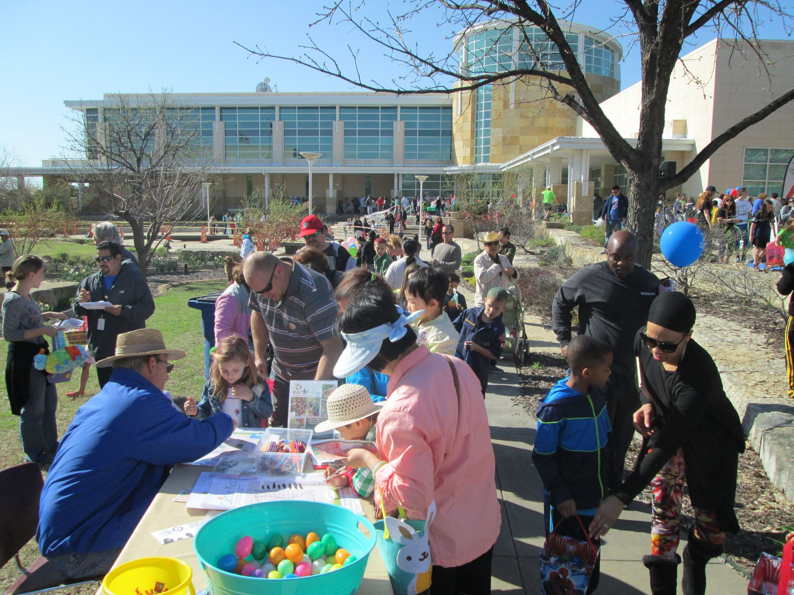 A large group of families participating in an Easter egg event